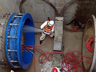 matt chlor team spraying chlorine into water main pipe