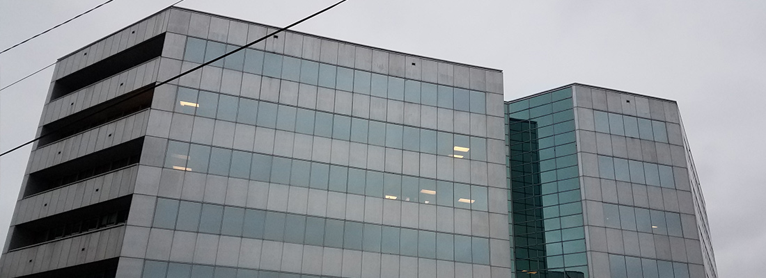 office building with cloudy grey sky