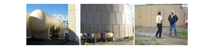 water storage facililties and 2 men standing in front of one water storage facility